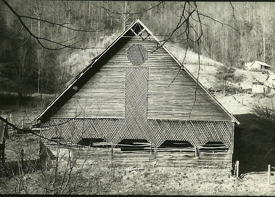 Masonic Grand Geometer symbol shown in gable peak in historic picture